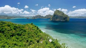 Aerial drone shot of remote coastline of Bacuit bay. Green jungle, turquoise ocean, tropical islands. El Nido, Palawan. Philippines. Summer and travel vacation stock video