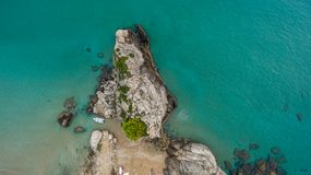 Aerial drone shot of a rock and beautiful turquoise waters at Corfu Greece.  Stock Image