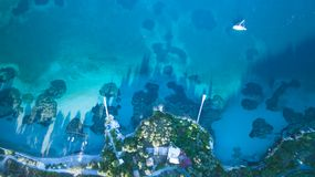 Aerial drone shot of a rock and beautiful turquoise waters at Corfu Greece.  Stock Photography