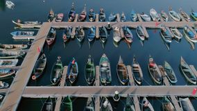 Colorful fishing boats docked in marina or port stock footage