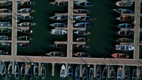 Colorful fishing boats docked in marina or port stock video footage