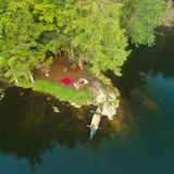 Aerial drone shot of tent Campsite,campfire and Canoe in the Adirondack Mountains. Aerial drone shot of tent Campsite and canoe in the Adirondack Mountains stock photography