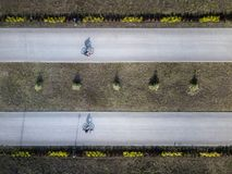 Aerial drone shot of two bike rining trough the park stock image
