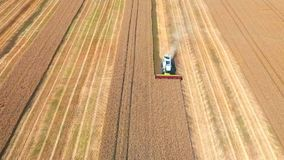 Aerial drone shot of a two combines harvesters working day in big a field. FHD stock footage