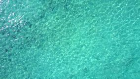 Aerial drone shot. A view of the corals from a bird`s eye view. The camera looks down and slowly rises. Turquoise water. Of the Caribbean Sea. Riviera Maya stock video footage