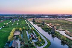 Free Aerial Drone Shot View Of Kinderdijk Wind Mills In The Filed Near Rotterdam In Netherlands Royalty Free Stock Photo - 163782535