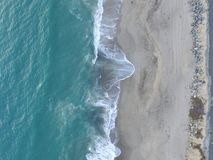 Aerial drone shot of waves and sand stock photo