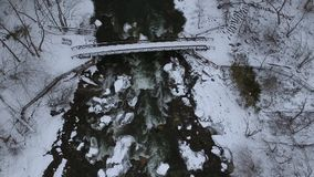 Aerial Drone shot of winter bridge at Chittenango Falls. Top down view stock video footage