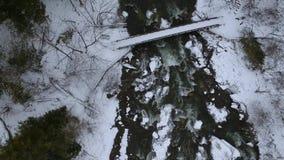 Aerial Drone shot of winter bridge at Chittenango Falls. Top down view stock video