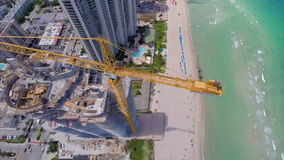 Aerial drone Sunny Isles Beach construction crane stock footage