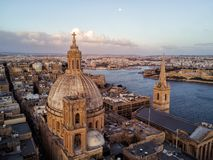 Beautiful drone photo of Valletta Malta at sunrise. Aerial drone sunrise Photo - Our Lady of Mount Carmel Basilica. A domed cathedral that overlooks the ancient royalty free stock photos