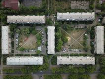 Aerial drone top down shot of downtown with houses and square courtyards. Magnitogorsk, Russia royalty free stock photography