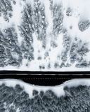 Aerial drone top view over car road in winter conditions royalty free stock photos