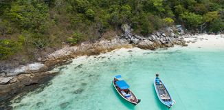 Aerial view of palm trees and sea with boats. Aerial drone top view of tropical landscape with palm trees and sea with boats Stock Photo