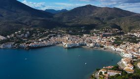 Aerial drone video footage of Cadaques Spain. the camera moves along the coast. sunny daylight. Mountains and the city stock video