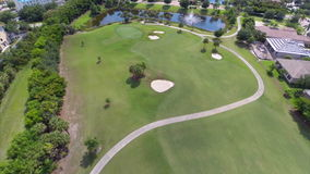 Aerial drone video golf course. Aerial video of a housing community with a golf course stock footage