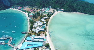 Aerial drone video of iconic tropical beach and resorts of Phi Phi island stock footage
