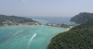 Aerial drone video of iconic tropical beach and resorts on Phi Phi island and Yong Kasem Bay called Monkey beach stock video footage