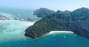 Aerial drone video of iconic tropical beach and resorts on Phi Phi island and Yong Kasem Bay called Monkey beach stock footage