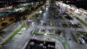Aerial drone video night shopping center