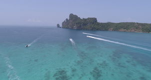 Aerial drone video of sailing boats and yachts in the bay of iconic tropical Phi Phi island stock video footage