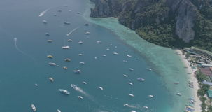 Aerial drone video top view of sailing boats in the bay of iconic tropical Phi Phi island stock footage