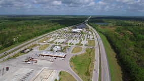 Aerial drone video Turnpike service plaza Fort Drum Florida stock video footage