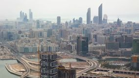Aerial drone view of Abu Dhabi city skyline, famous towers and skyscrapers.  stock video footage