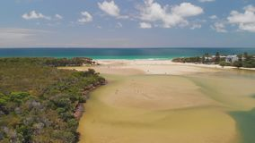 Aerial drone view of beach at Currimundi Lake, Caloundra, Sunshine Coast, Queensland, Australia. Aerial drone view of beach and Currimundi Lake, Caloundra stock footage