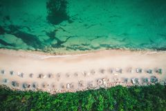 Aerial drone view of a beautiful beach with white sand and umbre Stock Photos