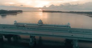 Aerial view of beautiful sea and bridge during sunset. Aerial drone view of beautiful sea and Sarasin bridge in Phuket during sunset , Thailand stock video footage