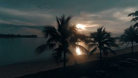 Aerial view of beautiful sunset. Aerial drone view of beautiful sunset over seascape and skylight on tropical island stock footage