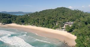 Aerial view of tropical island beach. Aerial drone view of beautiful tropical island  sandy beach and sea waves during sunny summer day stock footage