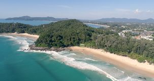 Aerial view of tropical island beach. Aerial drone view of beautiful tropical island  sandy beach and sea waves during sunny summer day stock video footage