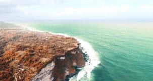 Aerial view of Uluwatu cliffs in Bali. Aerial drone view of beautiful Uluwatu cliffs in Bali, Indonesia stock video footage