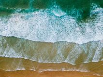 Aerial Drone View Of Blue Ocean Waves And Beautiful Sandy Beach Shore. In Portugal stock images