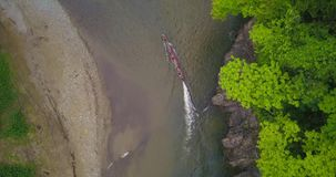 Aerial drone view of boat canoe in a river in the jungle of Panama. Aerial drone view of boat canoe of the Embera trine in a river in the jungle of Panama stock footage