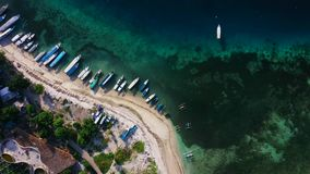 Aerial drone view of boats anchored in the bay with clear and turquoise water. Birds Eye shot, Overhead Shot, Helicopter or aerial drone view of boats anchored stock footage