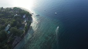 Aerial drone view of boats anchored in the bay with clear and turquoise water. Birds Eye shot, Overhead Shot, Helicopter or aerial drone view of boats anchored stock video