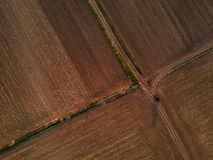 Aerial drone view of car on dirty countryside road Stock Image