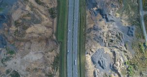Aerial drone view of cars driving on highway stock footage
