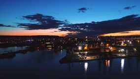 Aerial drone view of colorful sunset over sea port and industrial cranes, Varna seaport, Bulgaria.  stock video