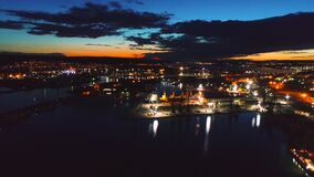 Aerial drone view of colorful sunset over sea port and industrial cranes, Varna seaport, Bulgaria. Aerial view of colorful sunset over sea port and industrial stock video footage