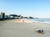 aerial drone view of Copacabana beachs during late afternoon,, some shadows can be seen on the sand. Rio de Janeiro, Brazil royalty free stock photo