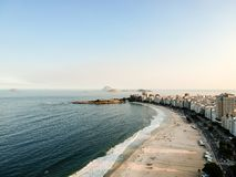 aerial drone view of Copacabana beachs during late afternoon,, some shadows can be seen on the sand. Rio de Janeiro, Brazil royalty free stock photography
