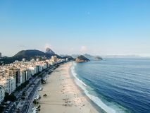 aerial drone view of Copacabana beachs during late afternoon,, some shadows can be seen on the sand. Rio de Janeiro, Brazil stock photo