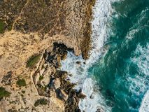 Aerial Drone View Of Dramatic Ocean Waves On Rocky Landscape. Aerial Drone View Of Dramatic Ocean Waves Crushing On Rocky Landscape royalty free stock photos