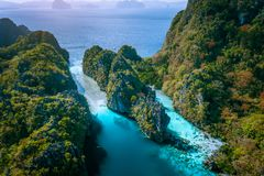 Aerial drone view of entrance to Big and Small Lagoon surrounded by steep cliffs El Nido, Palawan Philippines.  royalty free stock images