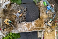 Aerial drone view on excavators demolishing a road bridge royalty free stock image