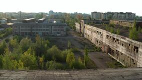 Aerial drone view. Flying over old factory ruin industrial building for demolition V2